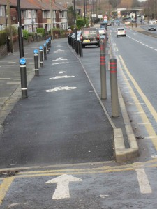 Separated by bollards and parking on the Great North Road