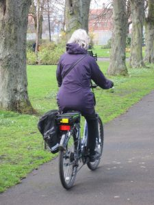 A rider on an electric bike in Gosforth Central Park