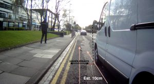 Picture taken from a bike camera showing a close pass