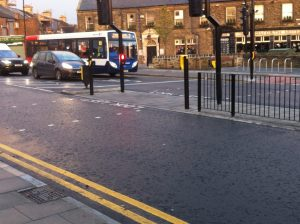 salters road crossing looking across towards the gosforth hotel. showing the pedestrian refuge in the middle of the road and vehicles queing at the traffic lights