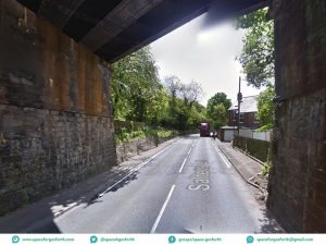 Picture showing the Killingworth Road Metro bridge with a narrow pavement on the left (east side) and no pavement on the right.