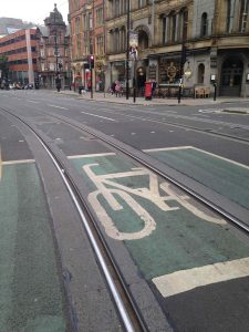 Picture of a bicycle advanced stop box with tram lines going through the middle that bike tires could get caught in.
