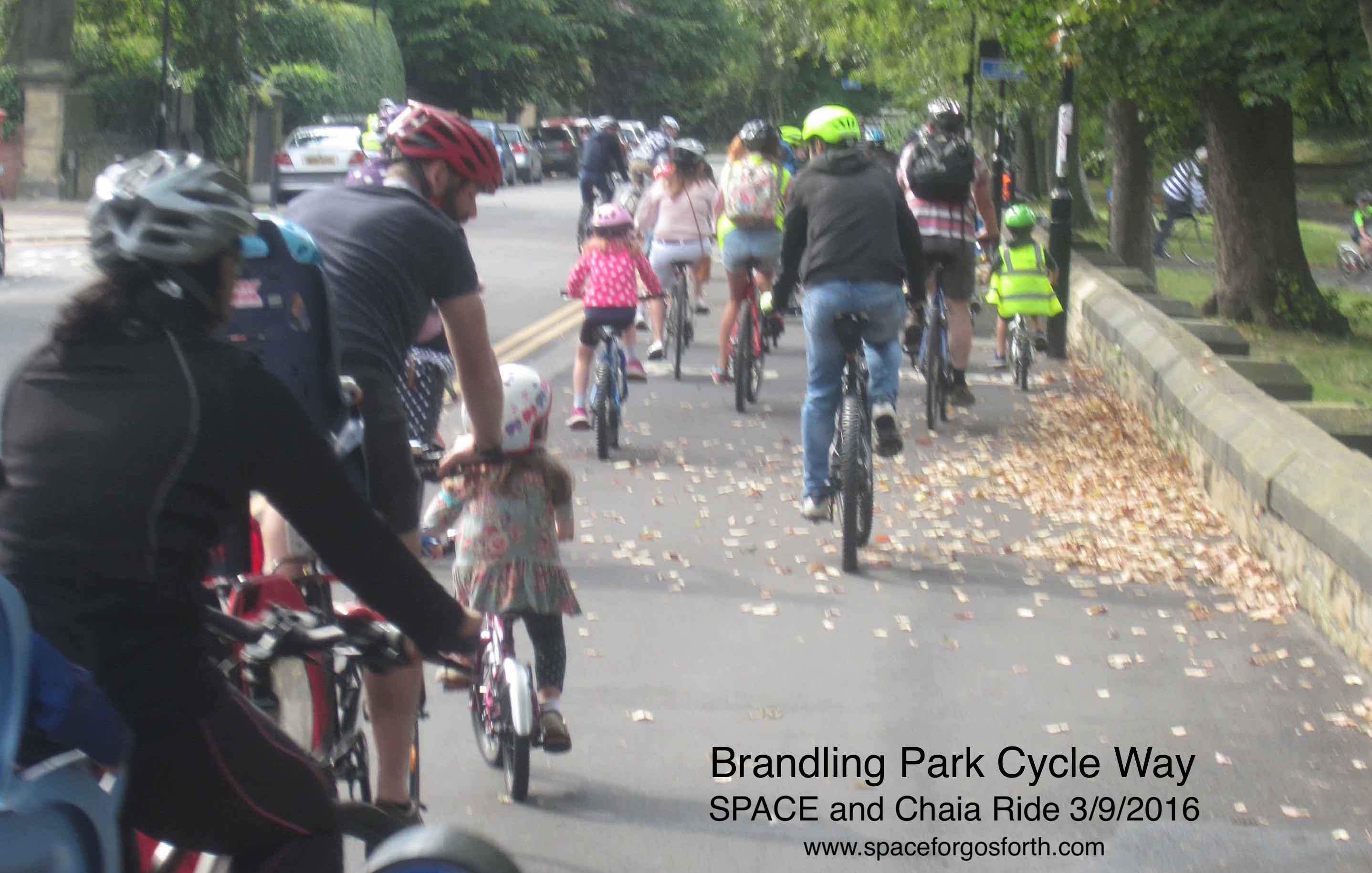 Families cycling along the traffic-free path at Brandling Park in Jesmond.