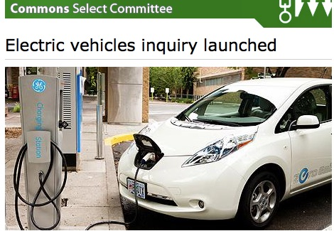 "Picture showing a plugged in electric car with text ""Electric Vehicles Inquiry launched"""