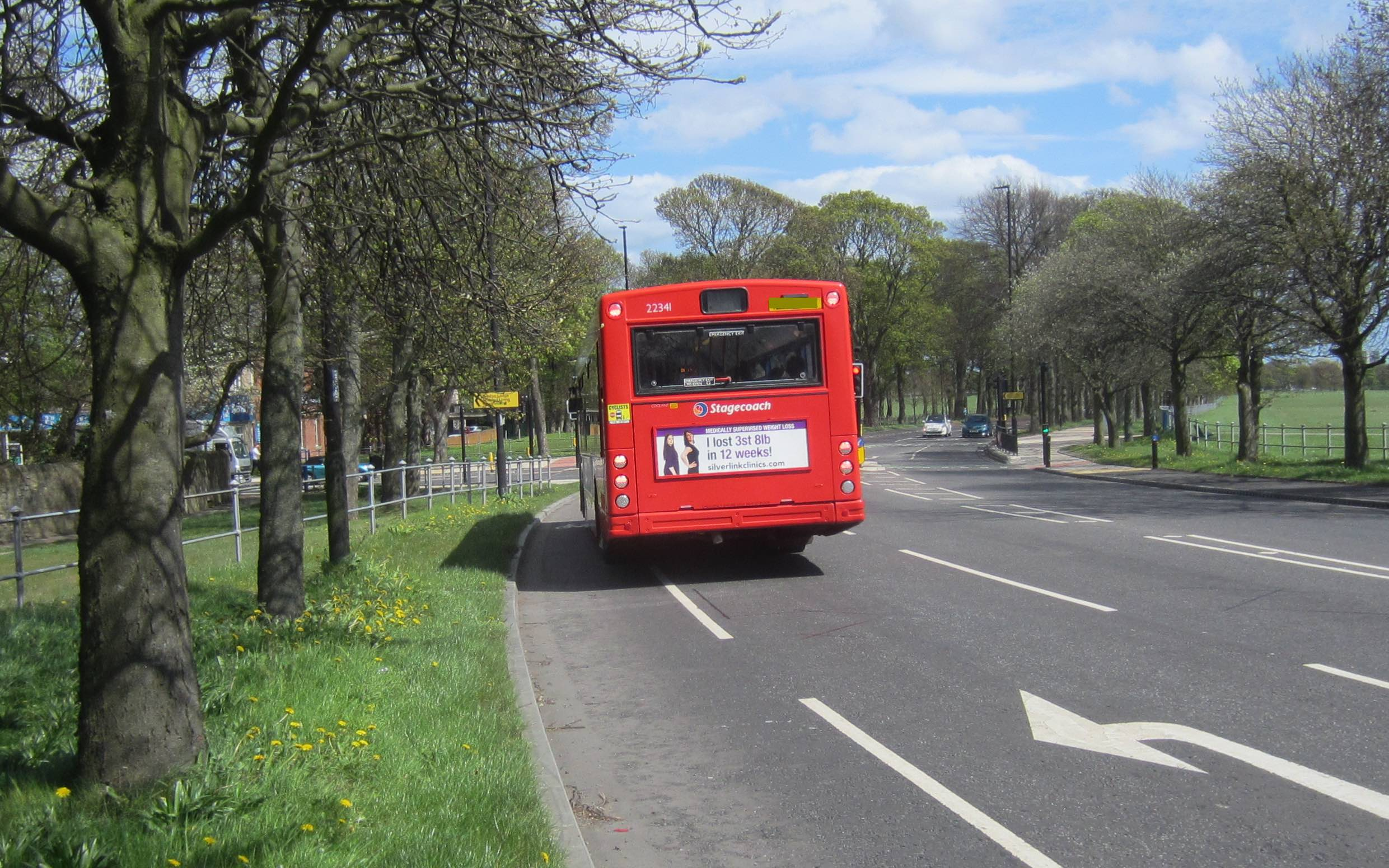 Bus waiting to turn left at the Kenton Road lights stopped partially in the cycle lane.