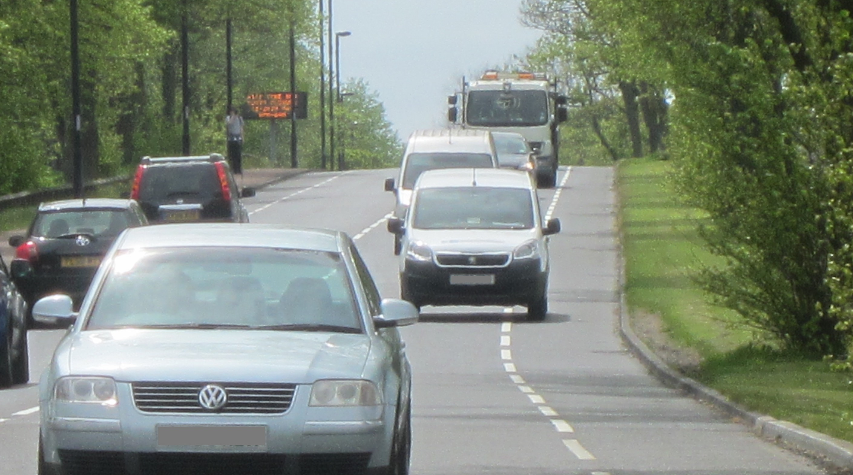 A second white van driving in the cycle lane on Grandstand Road