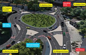 A giant roundabout plus traffic lights by Station Road / Hunters Road