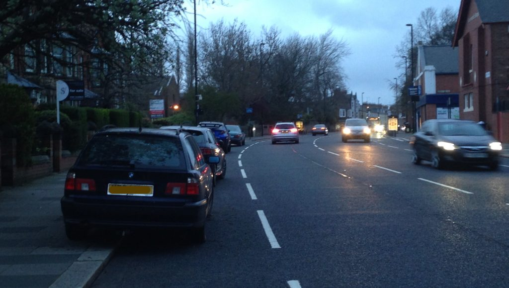 Picture of cars parked on the pavement / cycle lane on Gosforth High Street