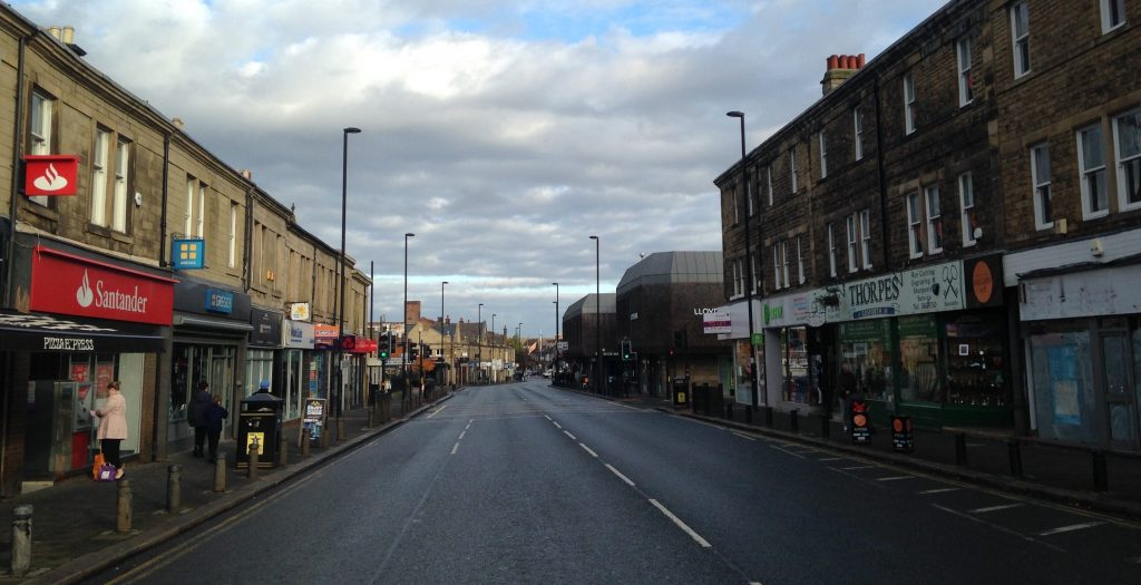 Picture of Gosforth High Street looking north from by Thorpes with no vehicles.