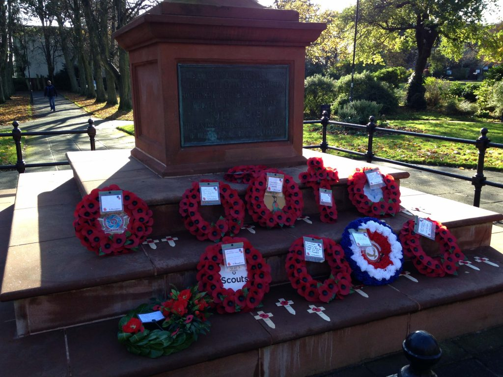 Picture of the Gosforth Central Park War Memorial including wreaths placed on Remembrance Day