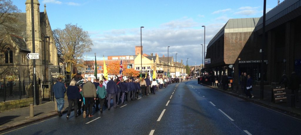 Picture of the Remembrance Sunday parade on Gosforth High Street returning to Woodbine Avenue.