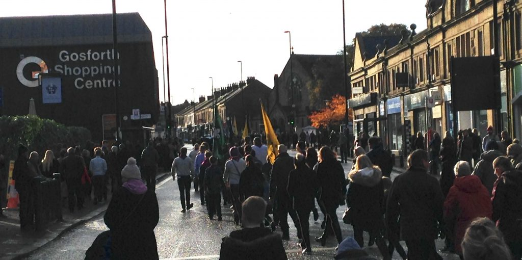 Picture of the Remembrance Sunday parade on Gosforth High Street heading towards Gosforth Central Park.