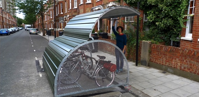 Picture of secure cycle storage instead of a car parking space.