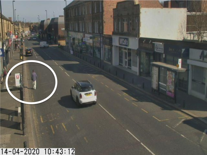 Traffic camera picture of Gosforth High Street with someone walking in the road.