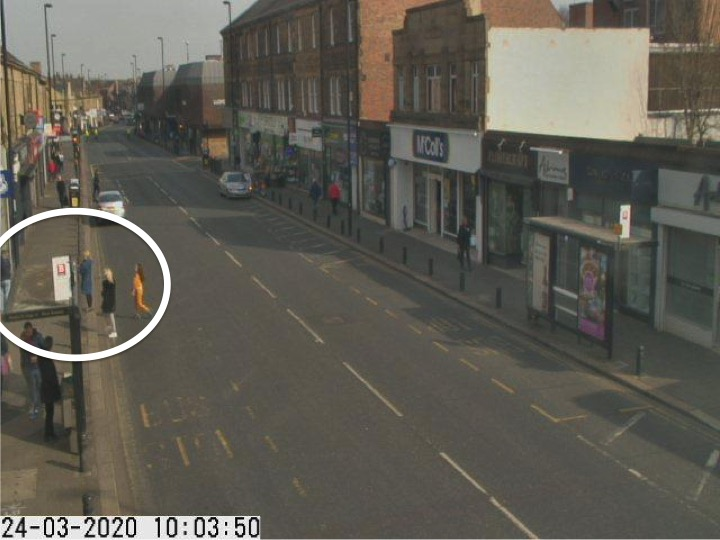 Traffic camera picture of Gosforth High Street with people waiting in the road for the cashpoint.