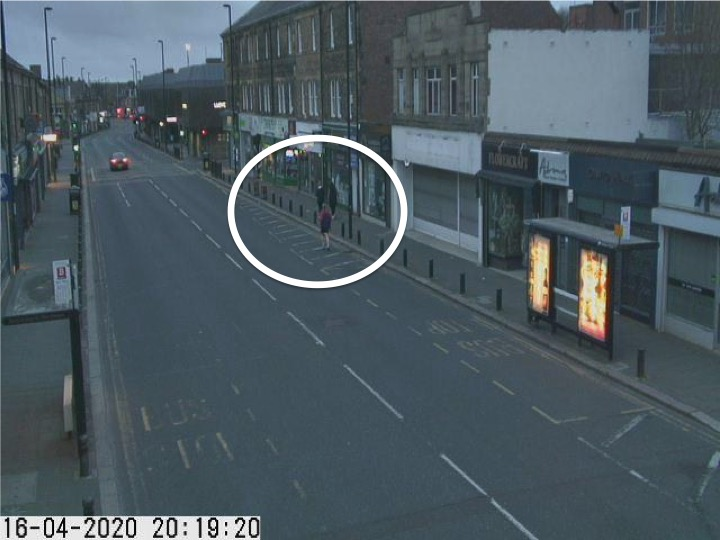 Traffic camera picture of Gosforth High Street with someone running in the road.