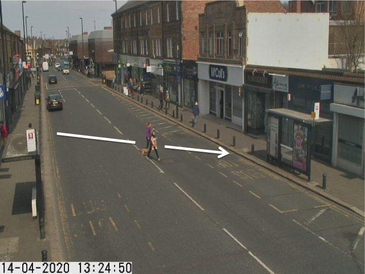 Traffic camera picture of Gosforth High Street with someone crossing the road.