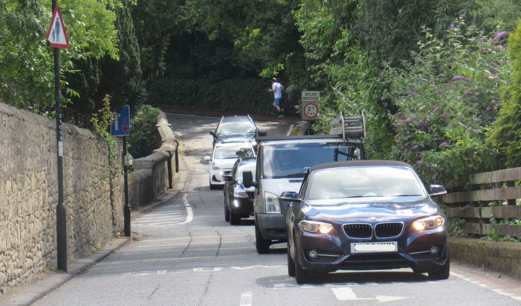 Picture of Castle Farm bridge with a queue of traffic
